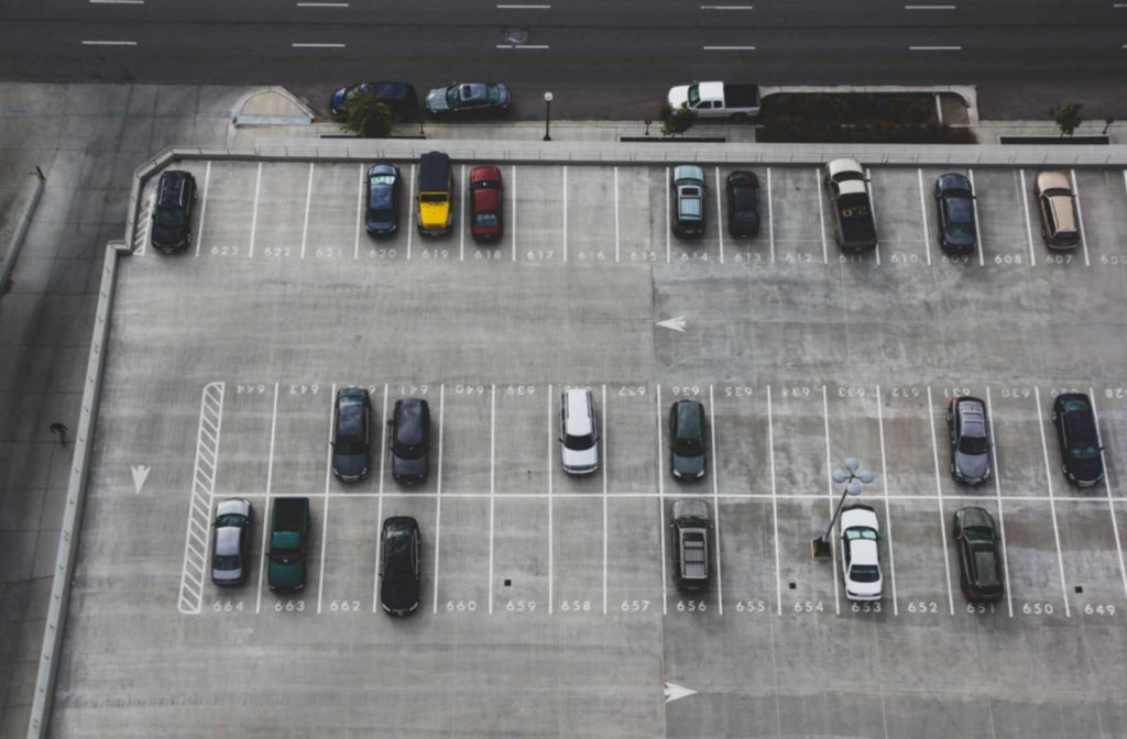 Parking lot occupied by a few cars